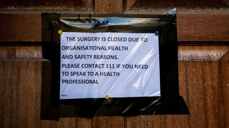 A sign on the front door of a surgery in Brighton closed over coronavirus fears