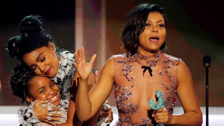 """FILE PHOTO: Taraji P. Henson (R) and Janelle Monae accept their award for Cast in a Motion Picture for """"Hidden Figures"""" during the 23rd Screen Actors Guild Awards in Los Angeles, California, U.S., January 29, 2017. REUTERS/Mike Blake/File Photo"""