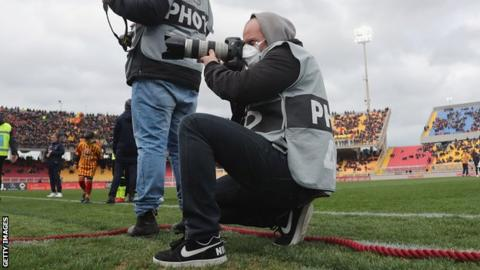 Photographer in mask