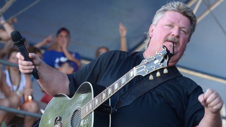 """MANHATTAN, KS - JUNE 28:  Singer/Songwriter Joe Diffie performs during """"Kicker Country Stampede"""" at Tuttle Creek State Park on June 28, 2014 in Manhattan, Kansas.  (Photo by Rick Diamond/Getty Images for Neste Event Marketing)"""