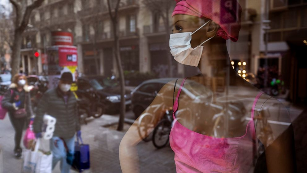 Spain limits movements, closes shops to stem virus spread