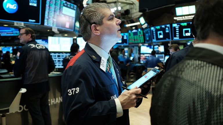 Traders work on the floor of the New York Stock Exchange (NYSE) on March 17, 2020 in New York City