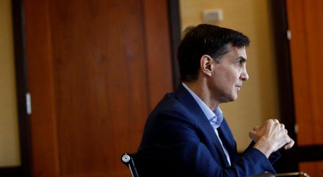 US university tracking virus' spread warns of layoffs, cuts