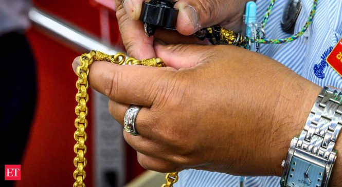 Rush for gold loans seen as Indians seek refuge from slowdown