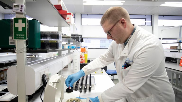 A scientist tests for coronavirus at Glasgow Royal Infirmary