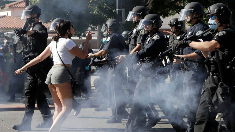 A protester confronts San Jose police as they advance on Friday, May 29, 2020, in San Jose, Calif