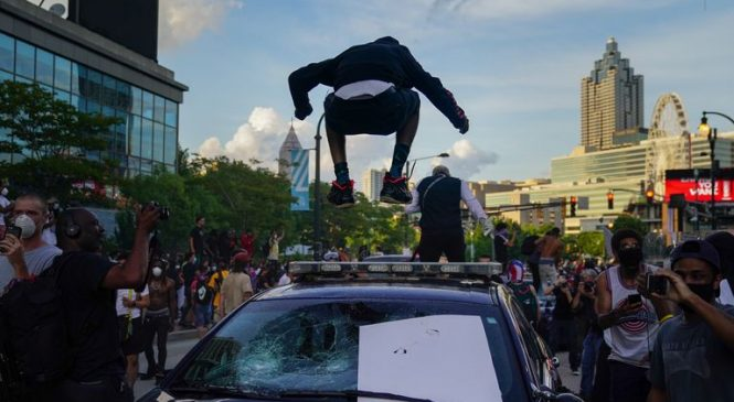 Teenage demonstrator shot dead as thousands protest George Floyd death