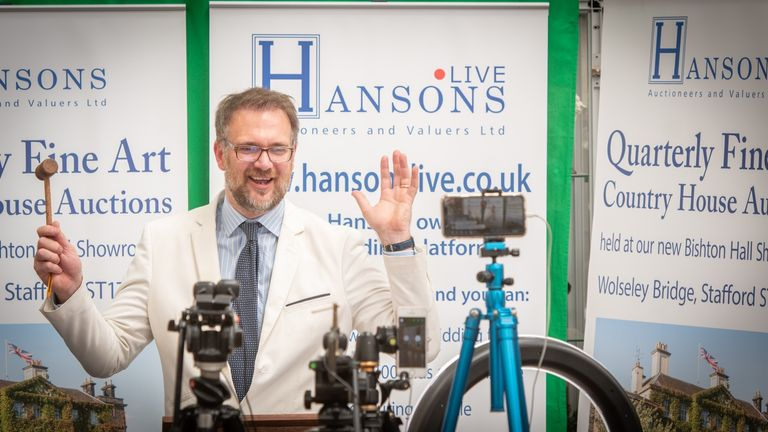 Auctioneer Charles Hanson bringing the hammer down on the books. Pic: Hansons