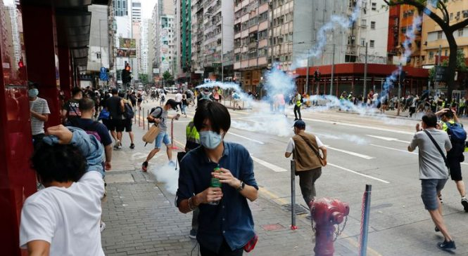 Hong Kong protesters hit with teargas as world figures condemn China's plans for security law
