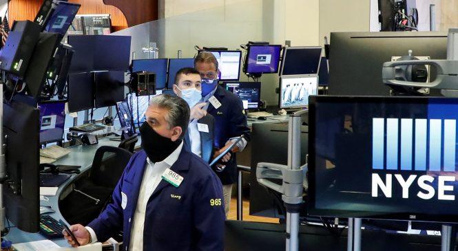 Stock futures drop as U.S. coronavirus cases surge to record levels