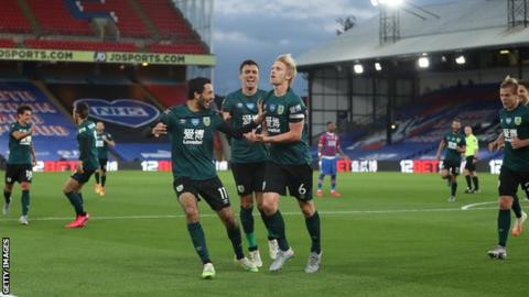 Ben Mee (centre) celebrates with Burnley team-mates