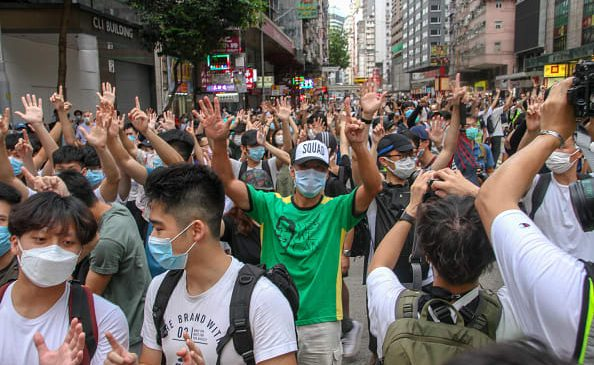 Hundreds arrested in Hong Kong protests, as analysts weigh in on national security law's impact