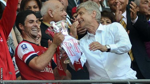 Mikel Arteta celebrates with boss Arsene Wenger following Arsenal's victory over Hull City in the 2014 FA Cup final