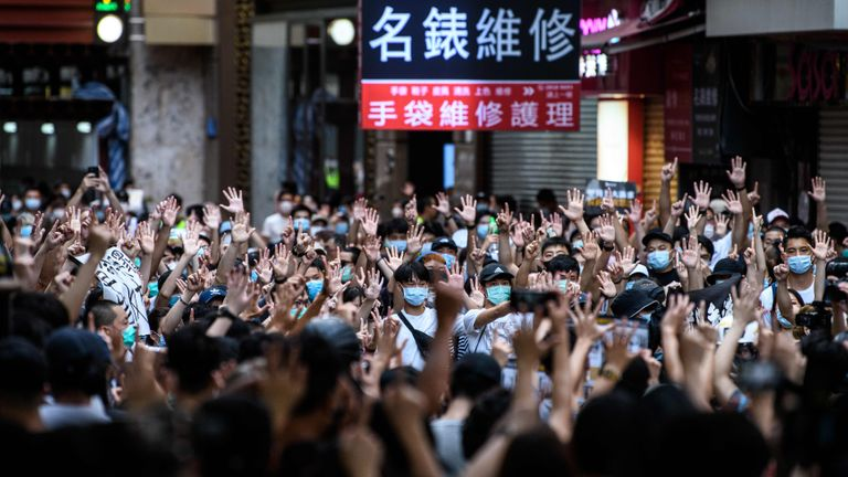 TOPSHOT - Protesters chant slogans and gesture during a rally against a new national security law in Hong Kong on July 1, 2020, on the 23rd anniversary of the city's handover from Britain to China. - Hong Kong police arrested more than 300 people on July 1 -- including nine under China's new national security law -- as thousands defied a ban on protests on the anniversary of the city's handover to China. (Photo by Anthony WALLACE / AFP) (Photo by ANTHONY WALLACE/AFP via Getty Images)