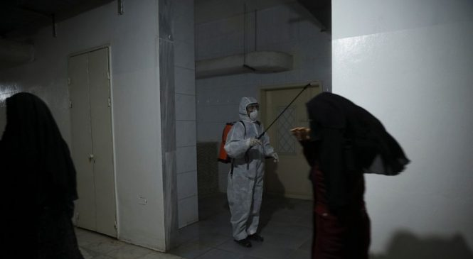 Syrians vote for new parliament amid measures against virus