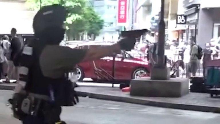 Officer pulls gun on Hong Kong protesters