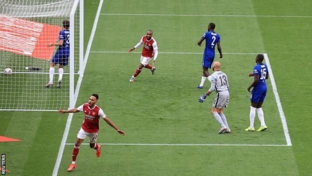 Pierre-Emerick Aubameyang wheels away in celebration after hitting Arsenal's winner against Chelsea
