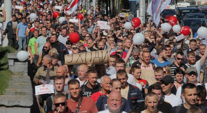 Embattled Belarus leader jeered by workers as strikes grow