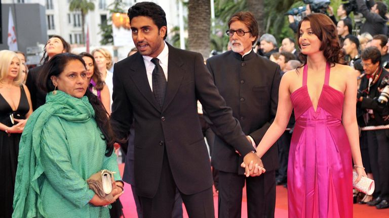 Bollwood star Amitabh Bachchan, 77, (3rd R) and his son (2nd R) are in hospital with COVID-19