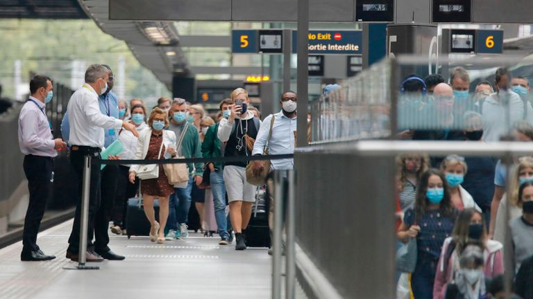 Eurostar passengers arriving from Paris in France at London's St Pancras station today after new UK quarantine rules are announced