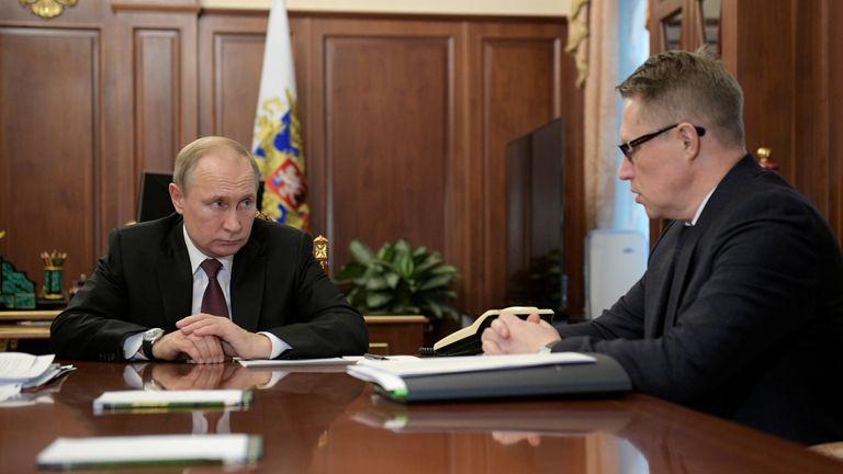 Russian President Vladimir Putin listens to minister of health Mikhail Murashko during a meeting on preventing the spread of coronavirus