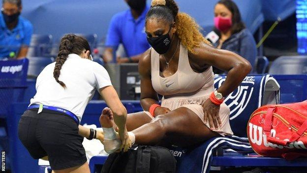 Serena Williams having treatment on her foot