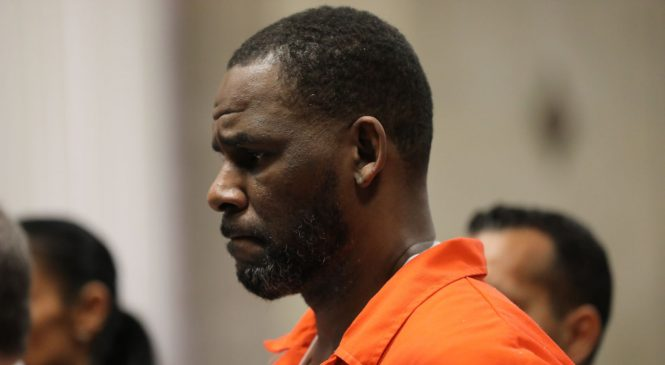 Convicted gang member claims to have beaten up jailed singer R Kelly