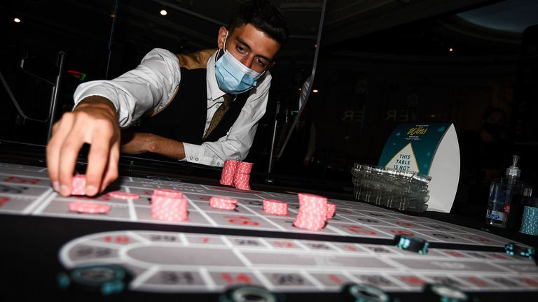 Staff clean chips with antibacterial wipes at The Rialto casino in central London as they prepare for reopening at midnight as coronavirus lockdown measures continue to be eased in England. PA Photo. Picture date: Friday August 14, 2020. See PA story POLITICS Coronavirus. Photo credit should read: Kirsty O'Connor/PA Wire