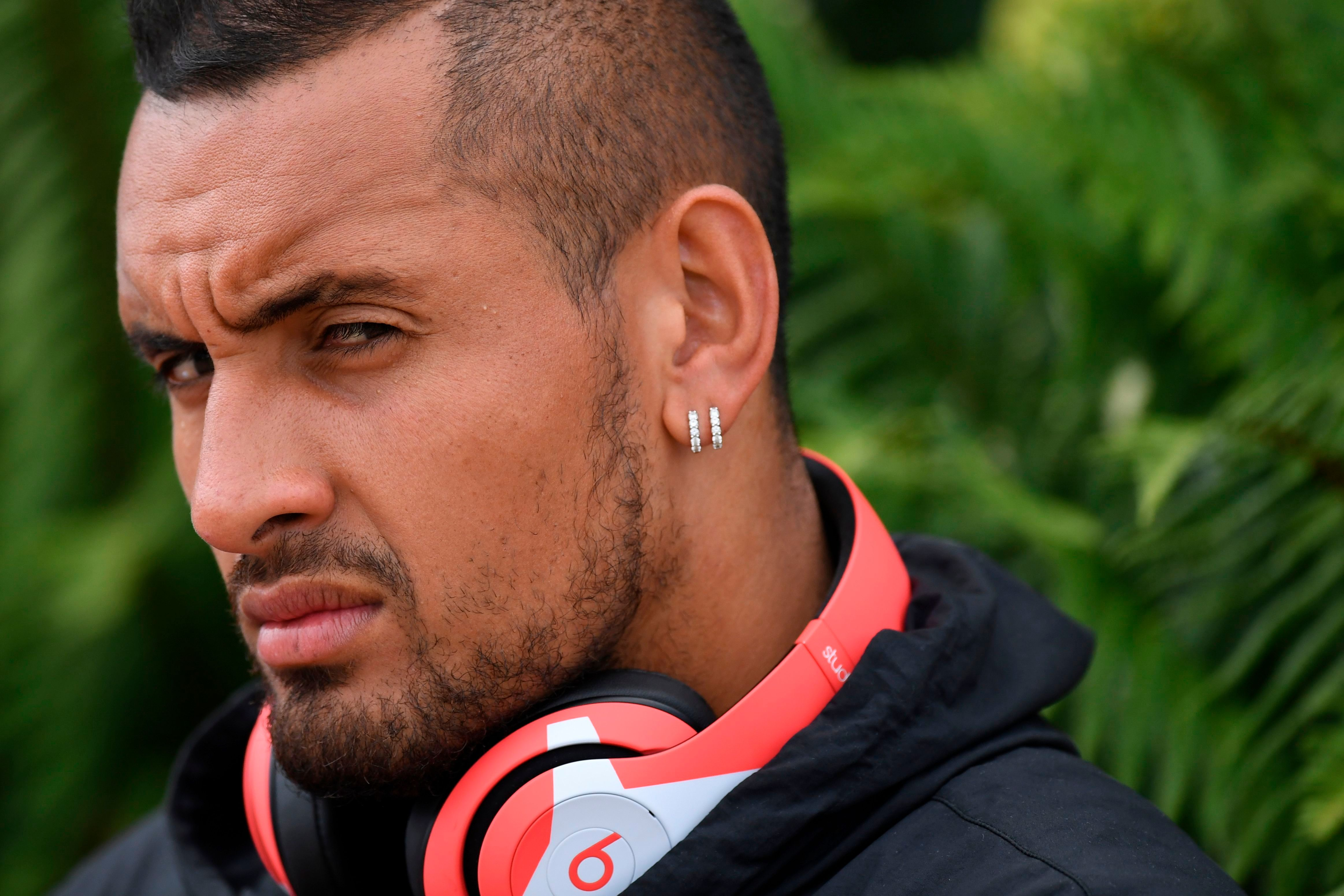 Nick Kyrgios admits sleeping with fans is a 'weekly thing' and he got distracted during a match with Roger Federer by an attractive woman