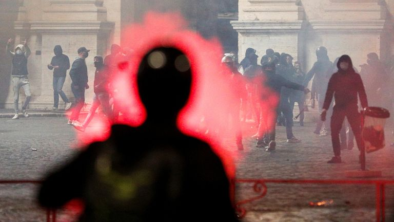 SENSITIVE MATERIAL. THIS IMAGE MAY OFFEND OR DISTURB Far right demonstrators clash with police during a protest over the restrictions put in place to curb the coronavirus disease (COVID-19) infections in Rome, Italy October 27, 2020. REUTERS/Guglielmo Mangiapane