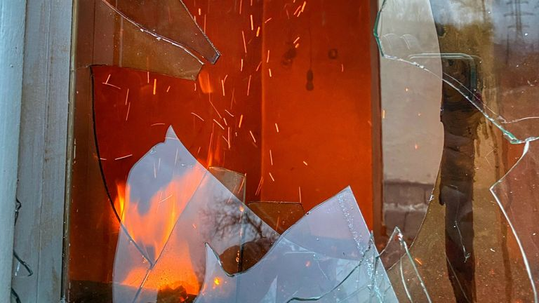 Sparks fly in a burning property