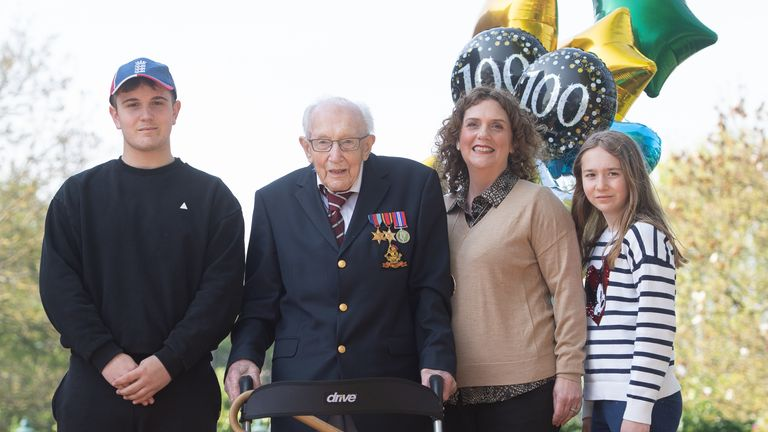 Cpt Tom Moore, with (left to right) grandson Benji, daughter Hannah Ingram-Moore and granddaughter Georgia