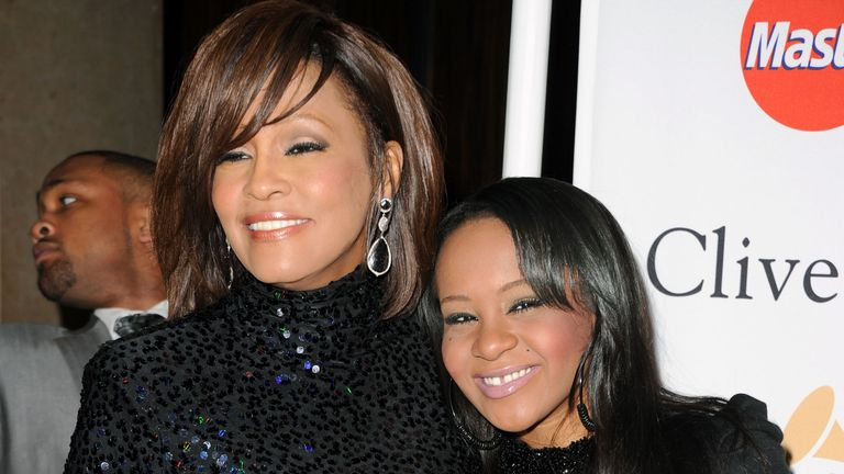Whitney Houston, left, with her daughter Bobbi Kristina
