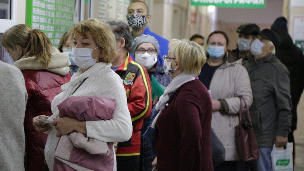 People wait in line at Omsk's City Hospital No 17 in November