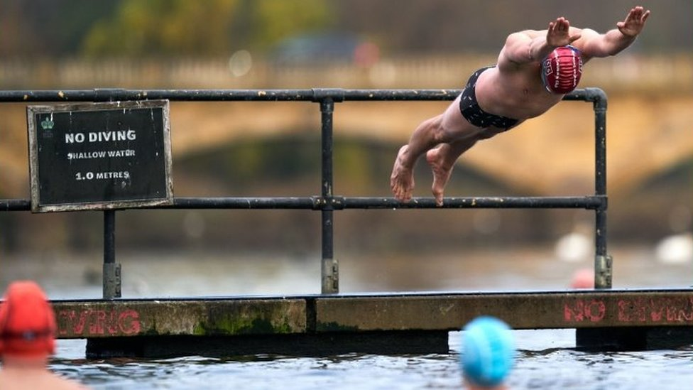 A swimmer takes to the water at Serpentine Swimming Club