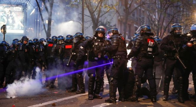 Police clash with protesters in Paris as violence flares at anti-security bill demos
