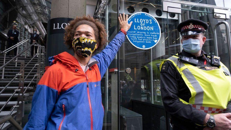 Protestor outside Lloyd's of London building.