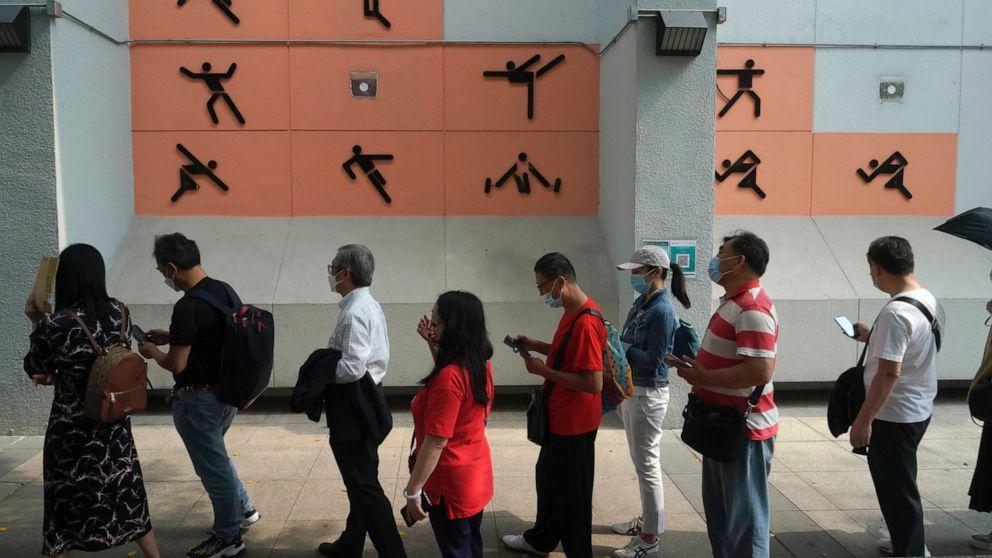 The Latest: Hong Kong starts virus jabs at community centers