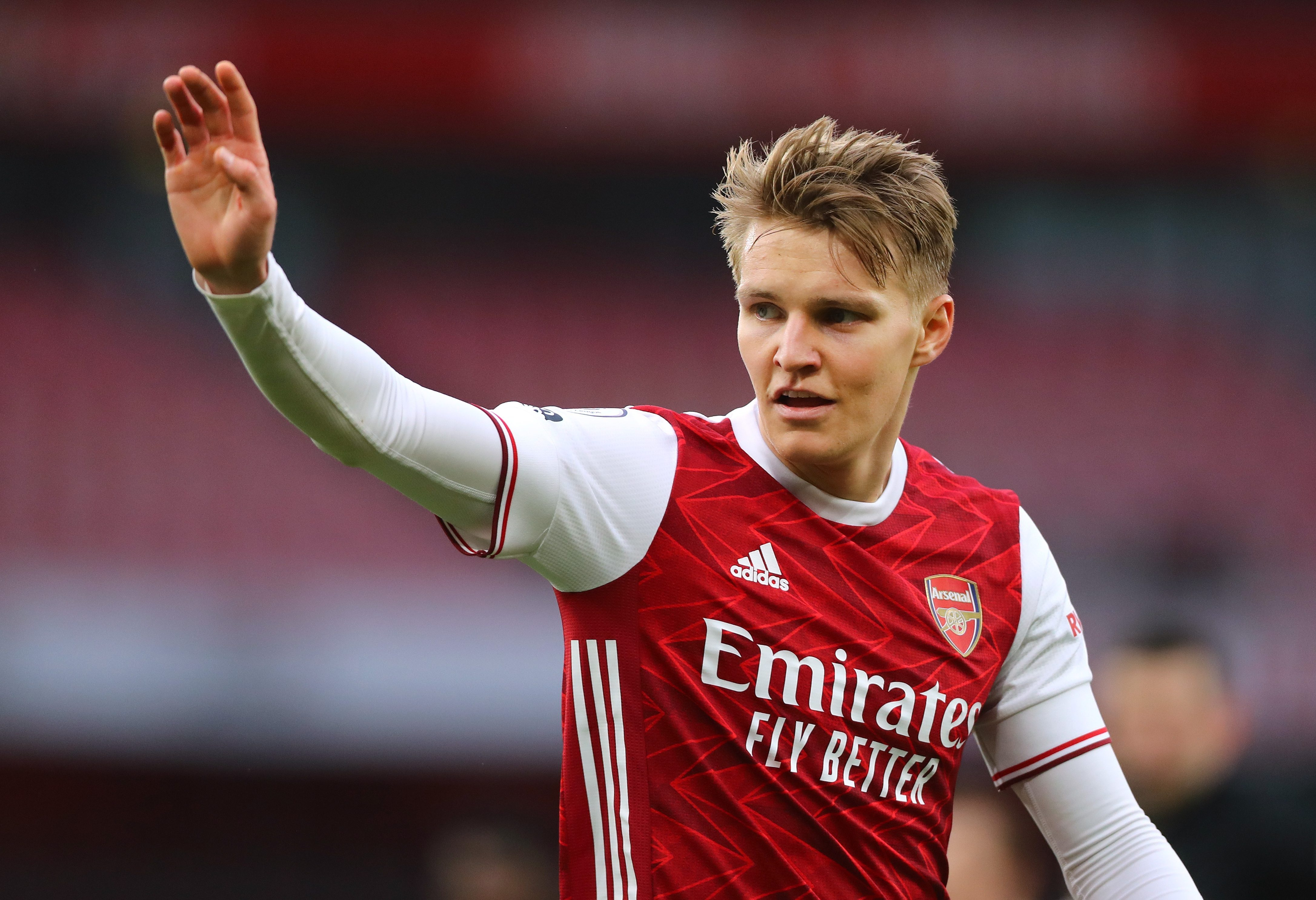 Chelsea and Liverpool 'to rival Arsenal for Martin Odegaard' as Premier League clubs set for battle to sign Real Madrid star in permanent summer transfer