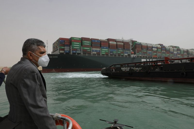 Officials preparing to remove cargo from Ever Given after 5 days blocking Suez Canal