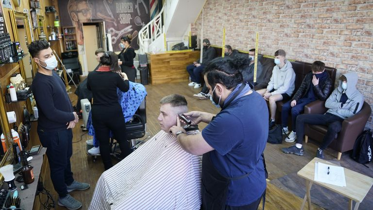 People get their hair cut at the Unique Traditional barber's in Whitley Bay, as England takes another step back towards normality with the further easing of lockdown restrictions. Picture date: Monday April 12, 2021.